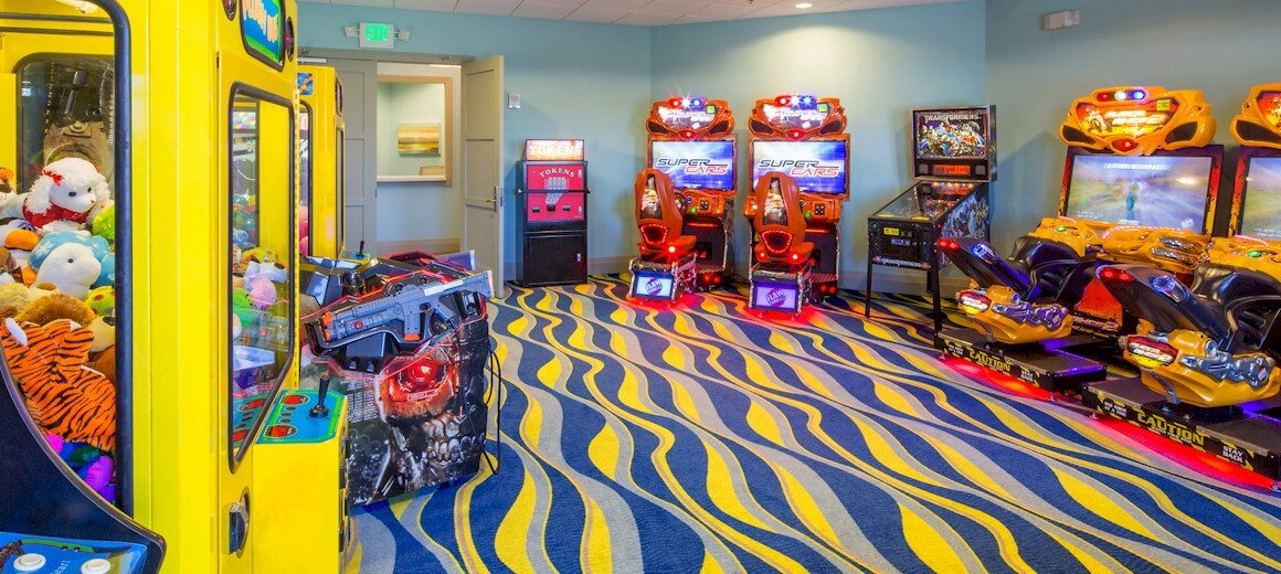 Arcade games room in the Oasis clubhouse