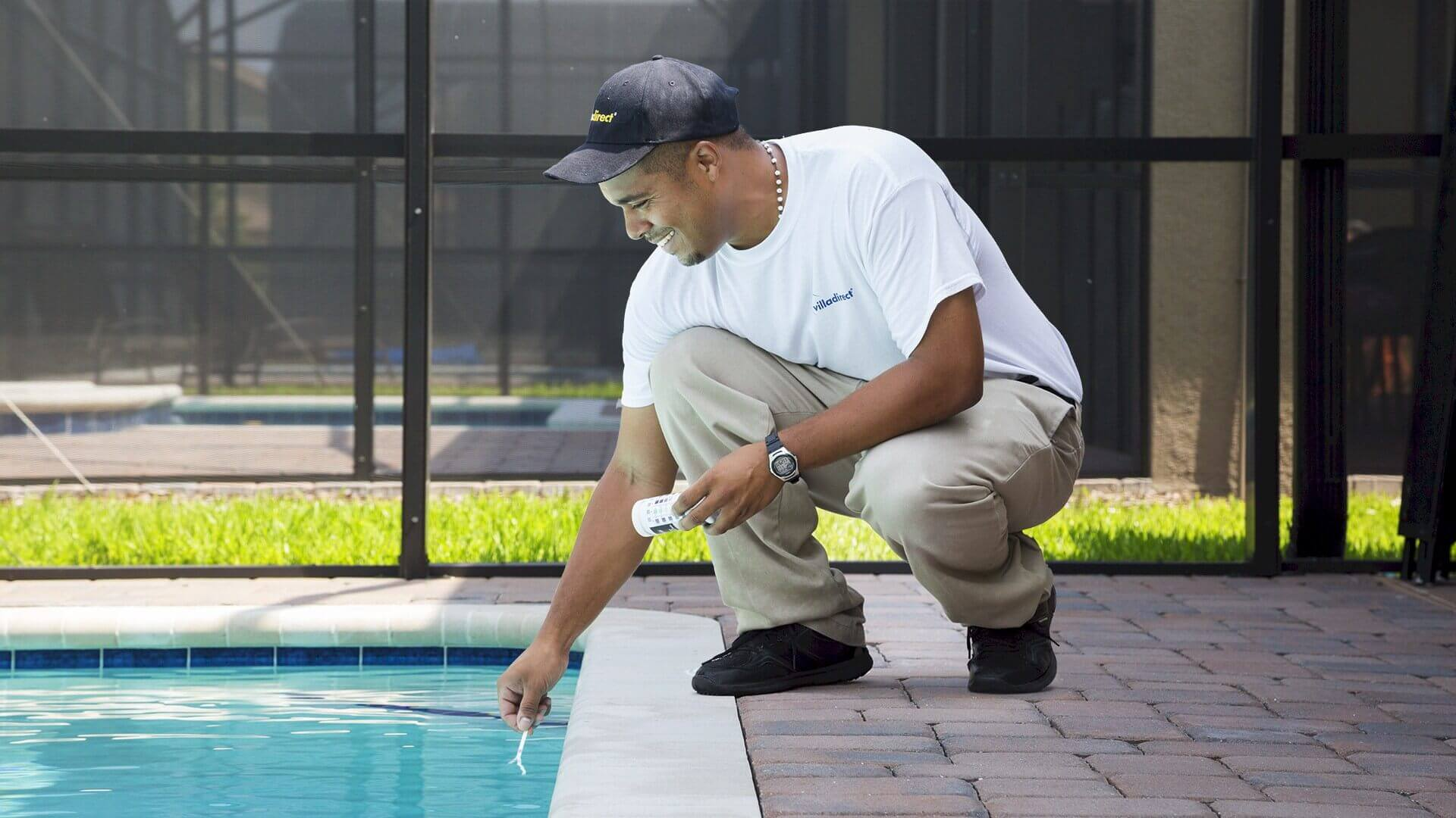 Pool technician testing water chemicals at ChampionsGate