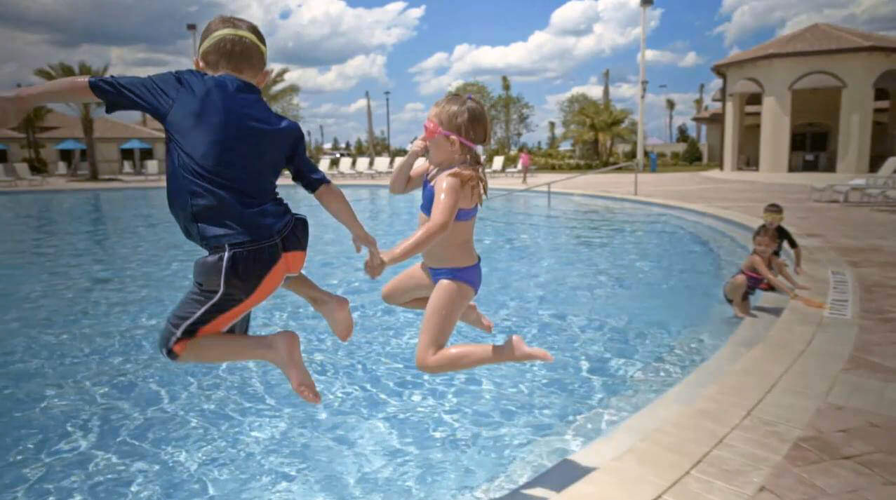 Kids jump into the lagoon pool at ChampionsGate